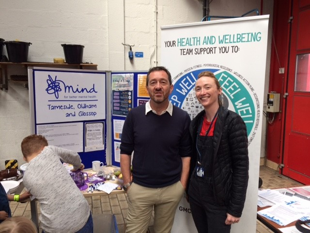 Jenny and Chris posing for a photo next to our TOG Mind charity stand.