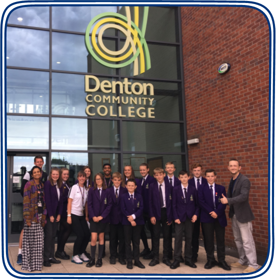 A group shot of students and staff at Denton Community College with Jason Bromley